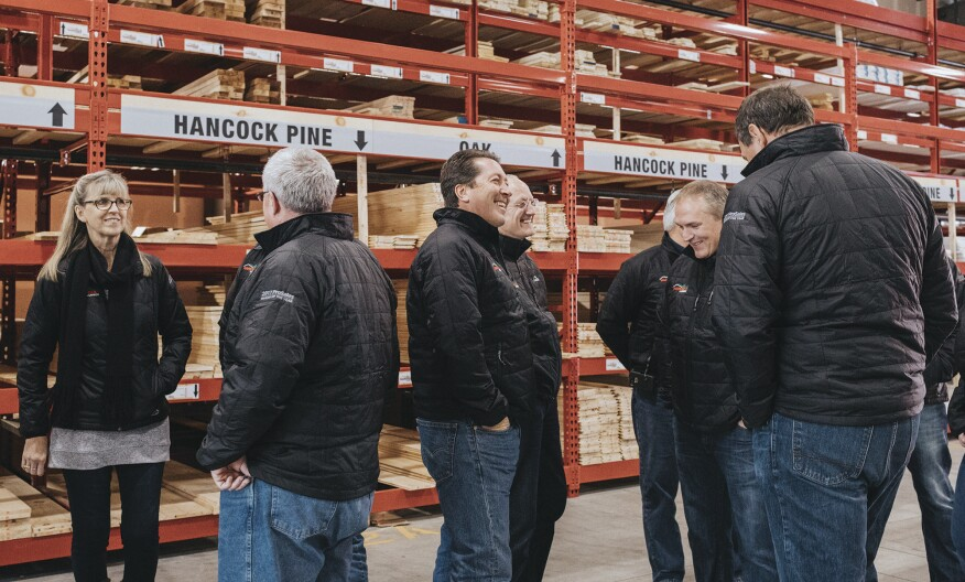 Senior members of the Hancock Lumber team chat as they get ready for a group shot