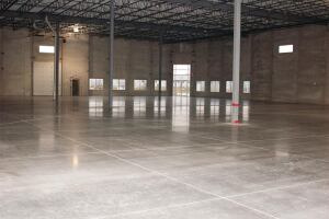 This warehouse floor is expected to have a long service life so its sustainable but not particularly green because mix ingredients didnt include any pozzolans. The shine on the floor was attained by hard-troweling.