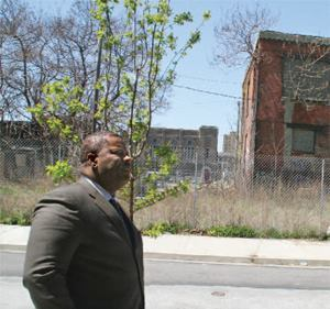 Carl R. Greene, executive director of the Philadelphia Housing Authority, surveys a parcel of land he says sparked a major dispute between PHA and HUD.