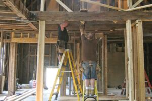 Nothing in the 150-year-old timberframe building was plumb, level, or square. The tops of the walls had bowed out from the weight of the roof and were as much as 2-1/2 inches out of plumb over 9 feet.