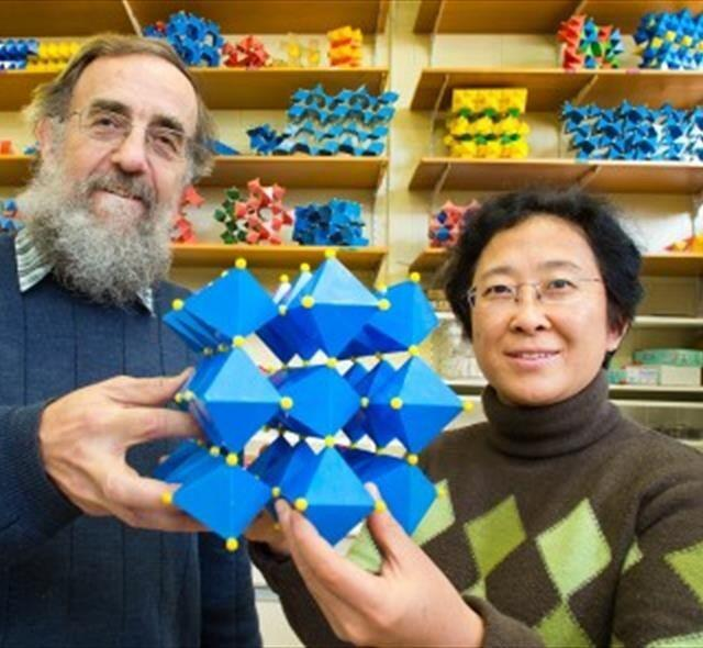 Researchers Ray Withers and Yun Liu with a model of a new dielectric material.
