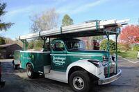 A Fleet of Vintage Work Trucks