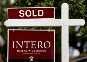 A real estate sign is photographed outside a home in Fremont, Calif., Dec. 9, 2015. (Anda Chu/Bay Area News Group)