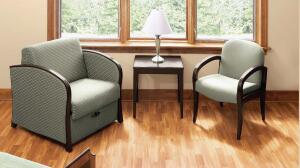Family members can read or check e-mail from the hospital while ensconced in KI's Flex lounge sleeper or patient chair, shown flanking a Flex end table.