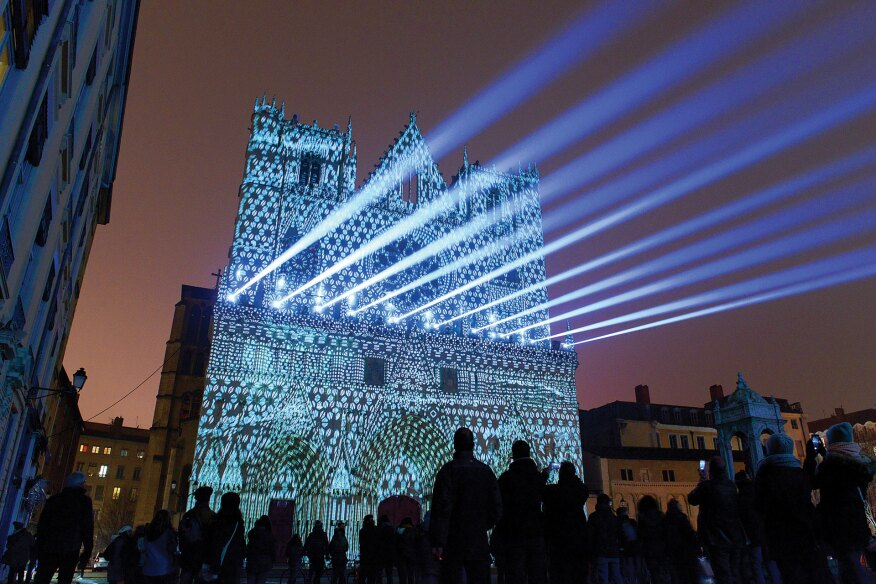 "A light projection show, ""Evolutions,"" by artists Yann Nguema and Ez3kiel, used the façade of Lyon's Saint-Jean Cathedral as a backdrop, and was one of the highlights of the 2016 Fête des Lumières."