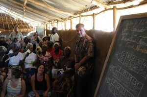 Skip Phillips, far right, celebrating a service in a Mozambican village.