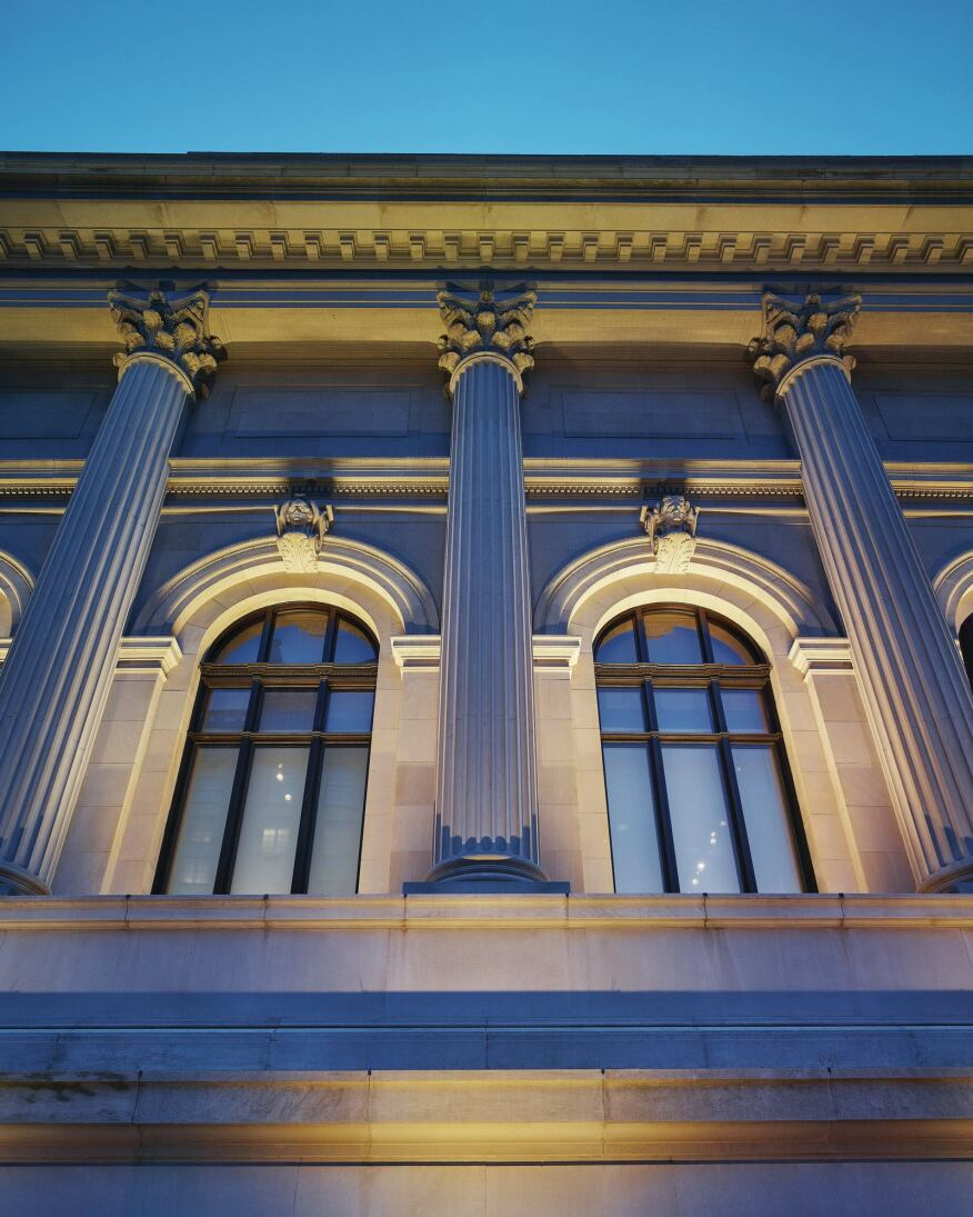 LED fixtures are discreetly positioned to convey the volume and depth of the façade elements, such as the cornice, columns, and windows.