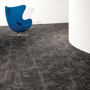 Milliken Contract's Ghost Artist carpet collection takes its inspiration from architectural details by unknown designers. It is available in four patterns—Facade (shown), Semblance, Trace, and Shadowpoint—in 16 coordinating colors. Durable enough for high-traffic areas, the carpets come in 50-centimeter-square modular Underscore ES Cushion tiles. They are carbon neutral and PVC-free; certified Sustainable Platinum under the SMaRT standards; and certified to Gold level under NSF 140.  millikencontract.com