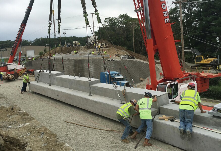 Separate precast footings connected by grouted splice sleeves.