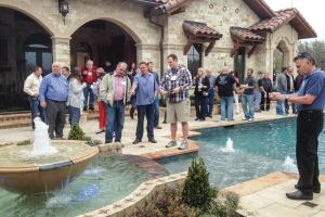 On display: Each of Master Pools' twice-yearly meetings features a tour of waterscapes by local   members. Here, professionals view and discuss one of three high-end projects by Claffey Pools of Southlake, Texas.