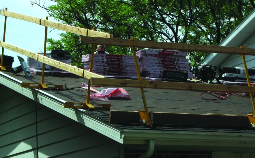 Code requires roofs to be built strong enough to carry more than just their own weight including live loads such as  the weight of workers and stacked up materials concentrated in small areas.
