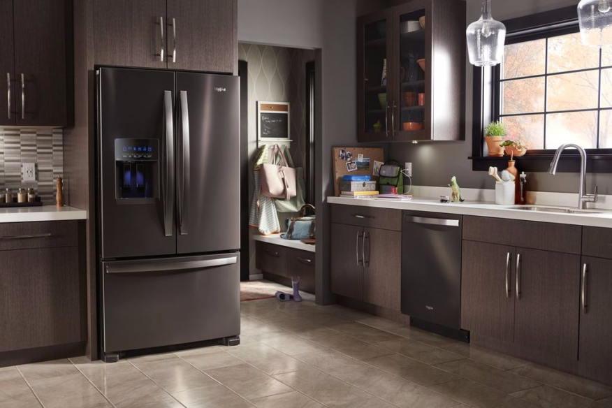 Expert q a how to accentuate new color finishes in the for Chocolate kitchen cabinets with stainless steel appliances