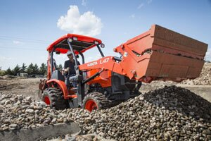 The Kubota L47 is a true three-in-one machine, capable of loading and excavating as well as having the capability to perform other work chores using auxiliary and/or PTO-driven implements.