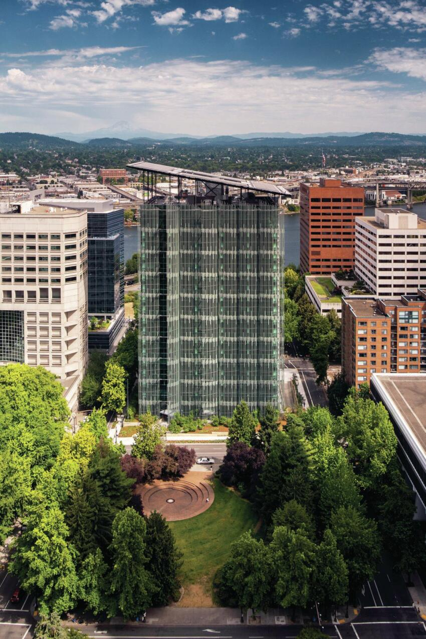 The Edith Green–Wendell Wyatt Federal Building is capped by a slanted roof clad in photovoltaics from Solar World. The angle was determined by solar studies to maximize the efficiency of the array.