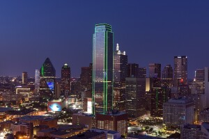 """The Dallas skyline in the evening. According to Redfin agent Sahar Pezeshki, Californians are """"coming in by the busloads"""" to Texas, owing to the cost savings on owning a home."""