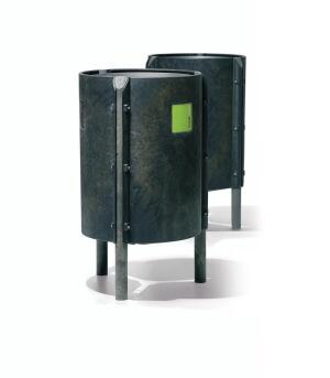 "Manufactured by Onadis of Spain and distributed in the U.S. by Magnuson Group, Recicla standing waste receptacles are constructed from Syntrewood, 100% recycled material made primarily from plastic. The material is pressed into thick, curved panels and round legs, which are then bolted together to form the three-legged round bin. A water-based dye gives the Recicla its dark green-gray color. Heavy-duty waste bags are secured by an internal metal ring. The bin stands 31-1/2"" tall and can hold up to 21 gallons of waste. A 31-15/16""-square surface space can be set aside for advertising. Kits are available for securing the bin to soft surfaces, as at beaches or playgrounds. magnusongroup.com"
