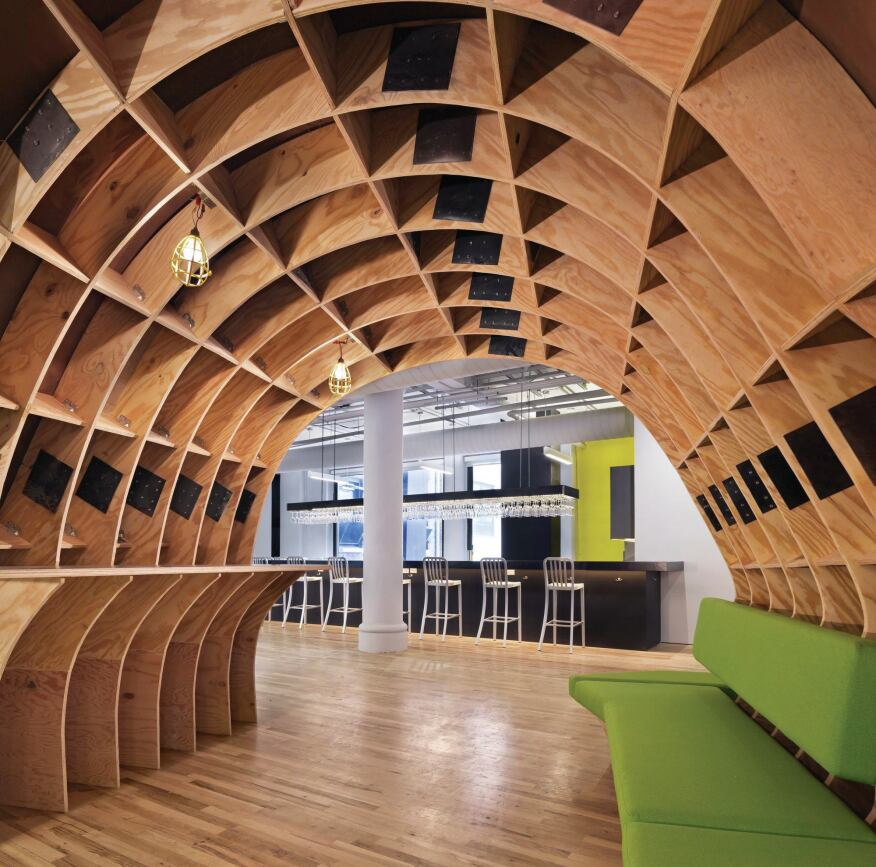 """When the superdesk was assembled, 4"""" steel plates were used to hold the plywood pieces in the arches together."""