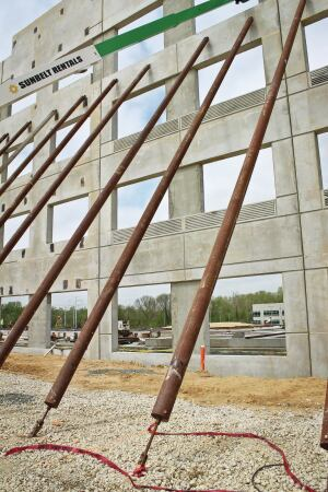 Helical ground anchors (HGAs) are used to brace walls from the outside when the floor slab is inadequate to support the bracing loads or on multistory panels to allow interior construction to proceed before roof installation.