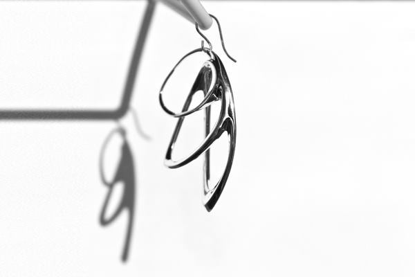 The Orbis earrings (shown) can be printed in polished nylon in white and black colors as well as cast in sterling silver.