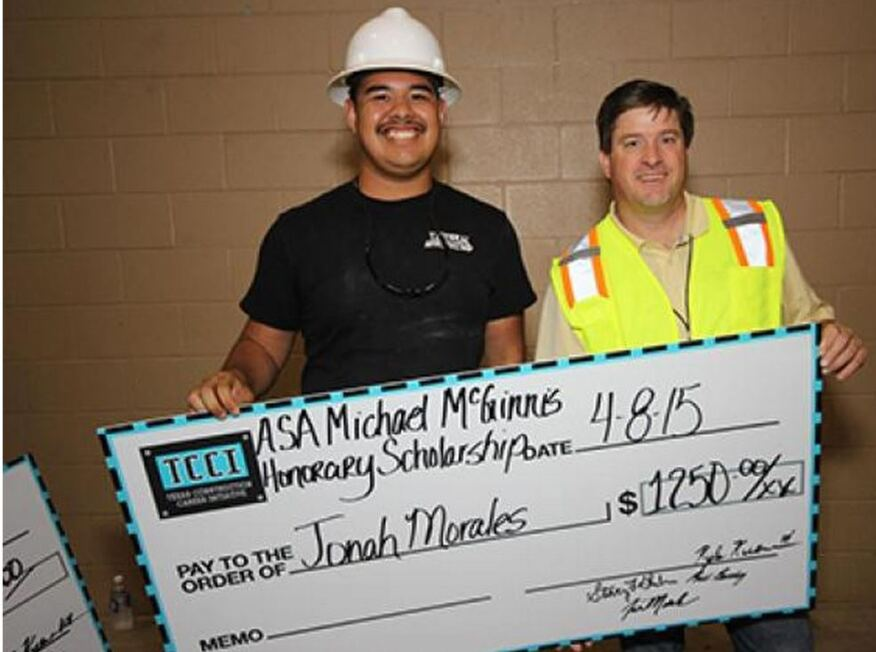 Jonah Morales accepts the ASA Mike McGinnis Honorary Scholarship from its namesake Mike McGinnis, Allen & Allen Co. The scholarship is part of the company's multi-step educational program.