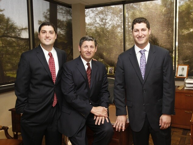 Scott Frankel, co-President and Principal of Frankel Building Group (left). Pictured with his father, Jim Frankel (center) and brother, Kevin Frankel (right).