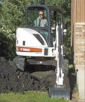 The ability to dig in the offset position is one of the compact excavator's great strengths
