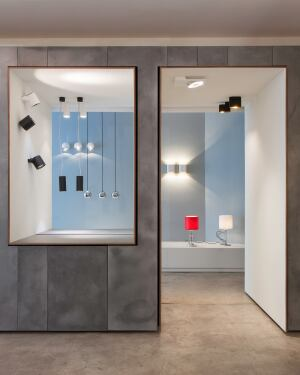 """The luminaires are displayed in an architectural framework that the architect dubbed """"light boxes."""""""