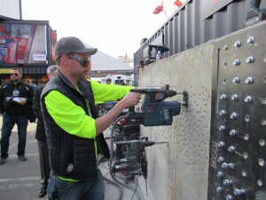 A cordless rotary hammer combined with a battery-powered dust collection system.