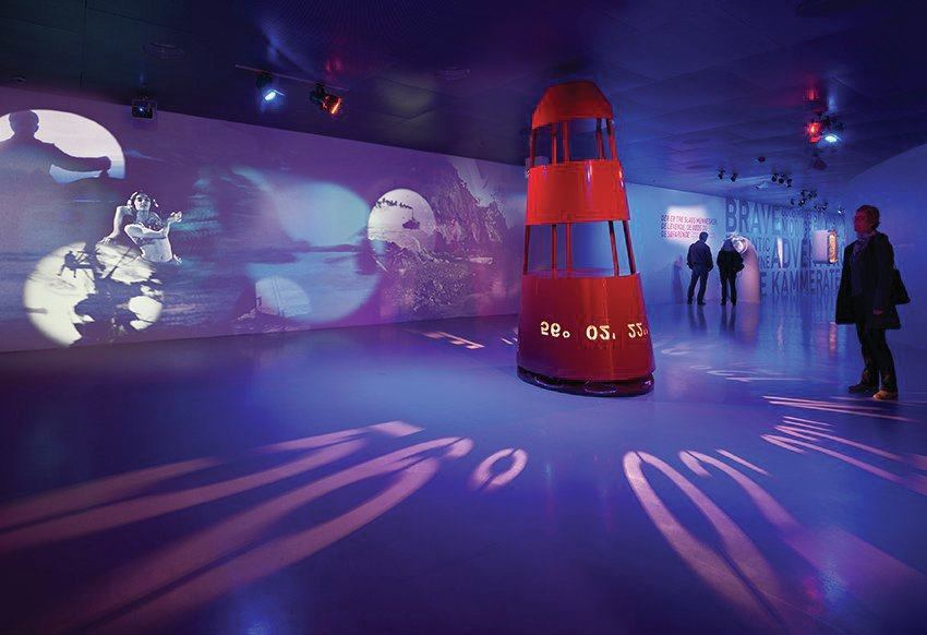 "In the first gallery, lighting is projected from a buoy and casts navigational coordinates on the floor, setting the stage for the visitors ""maritime"" journey."