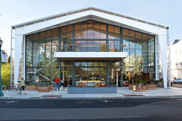 Shed, in Healdsburg, Calif., features a glass front facade that allows light and air, via operable garage doors, into the 10,600-square-foot space.