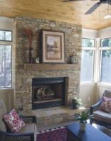 Figure 12. Even in the summer, a fireplace is this porch's focal point.