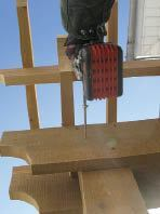 """Figure 7. Six-inch-long """"construction lags"""" fix the girders to the gate posts."""