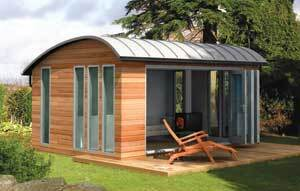 """STYLISH GETAWAY: A number of companies have noticed increasing demand for outbuildings and are creating smart, high-tech structures that can be used as a space for telecommuters or as a hobbyist's retreat. This is the """"Curved Lodge"""" model from the British company Decorated Shed."""