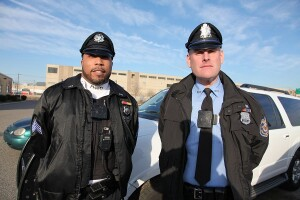 Sgt. Shayne Smith (left) and Officer Thomas Horner wear the body cameras in use by the Philadelphia Housing Authority Police Department.