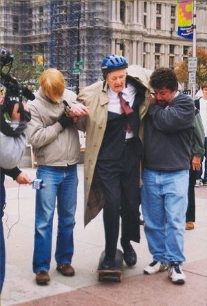 Bacon skateboarding 2002 in protest of the city's ban on skateboarding in LOVE Park. On Bacon's left is Howard Altman, former Editor of Philadelphia City Paper.