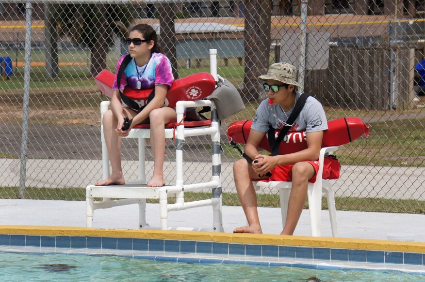 "March, 2015: Eliana Villarreal, 14, watches over the pool alongside her brother, lifeguard Nino Villarreal, during the lifeguard shadowing"" portion of the Junior Lifeguarding class as part of the Red Cross Centennial Campaign in at a Brevard County Parks and Recreation facility in Florida."