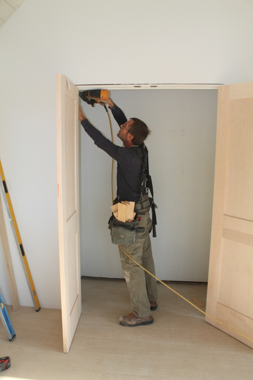 To install the double-door unit, start by driving a single nail through the jamb at each of the four corners.