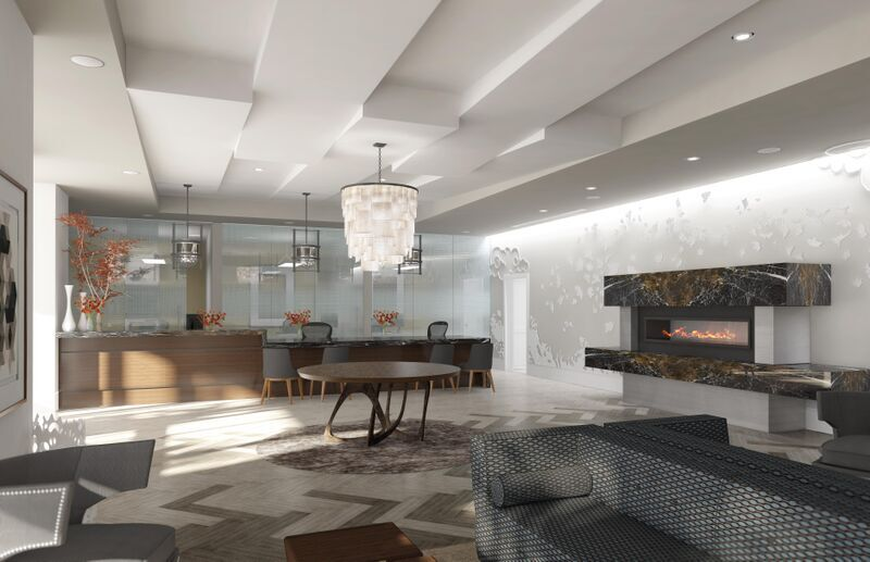 The lobby at 3601 Market features sophisticated decor with a fireplace.