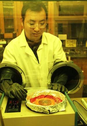 Researcher Min Cai creates a metal-oxide based OLED.
