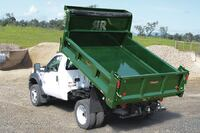 Lower mounting height for dump bodies