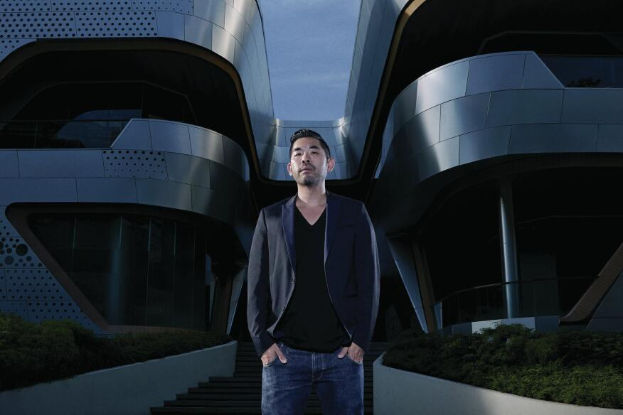 "Alvin Huang in front of ""The Groove"" at CentralWorld, a 129,167-square-foot entertainment and retail venue his firm completed late last year in Bangkok."