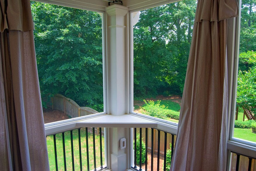 The beauty of PVC trim is its versatility; here it's used to create a maintenance-free corner nook on a porch.