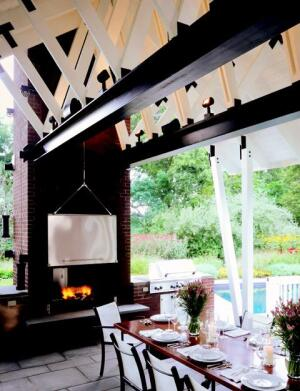 A two-sided fireplace caps one end of the pavilion. Stainless steel doors on both sides use a counterweight pulley system to allow the doors to be open or closed in any combination.
