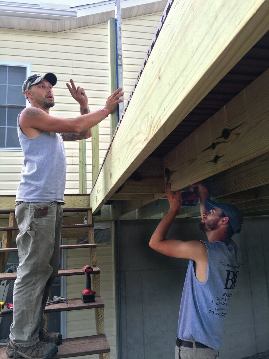 Blocking strengthens the framing where the joists run parallel to each other, such as along the side of the deck.