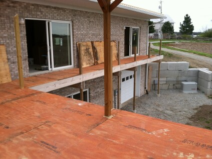 The author applied adhesive to the joists before fastening the 3/4-inch T&G plywood to the deck framing with screws.