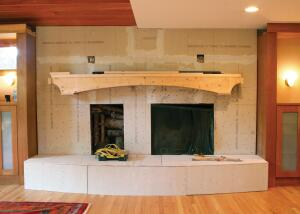 He took down the standard brick of the existing fireplace, framed and drywalled a new curved hearth, and then set to work using scraps of slate ó from India and South America ó salvaged from prior jobs. He used stone trim around the fireplace and the firewood storage box because it is more durable than wood.