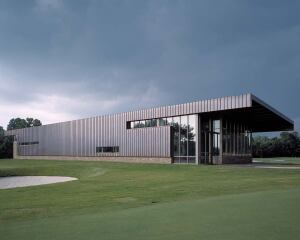 """side lines  Blackwell speced copper roofing for the siding on this University of Arkansas clubhouse. A strong vertical pattern in the metal sheathing contrasts with the building's tapered horizontal line. """"We really like metals that are reactive to the atmosphere,"""" Blackwell says. He often looks to local artisans with a knack for manipulating materials. Franklin, he says, is """"willing to work with us on unusual ideas and do them economically."""" Franklin & Son, 479.267.5544."""