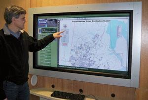 "This 57-inch interactive touchscreen ""lives"" in the lobby of the administration building. Hardware ($16,000) consists of a Samsung 570DXn LCD with Horizon Technologies Optical Touchscreen, Dell 755 Optiplex small form factor PC, UPS, and speakers. The system runs on Four Winds Interactive software ($5,000). Photo: City of Durham"