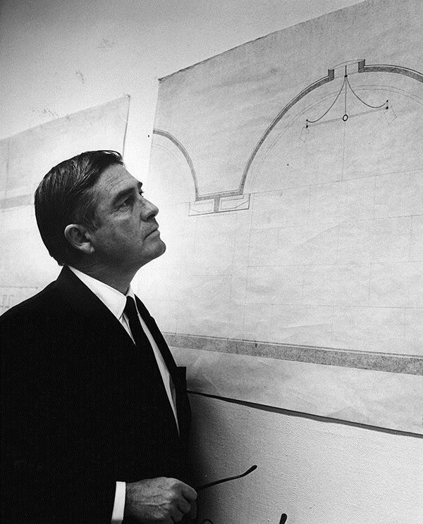 Richard Brown, the first director of the Kimbell Art Museum, looking at drawings (circa 1968).