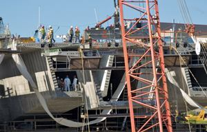 Workers build the segments of the I-35W bridge in Minneapolis. The original span collapsed in 2007, killing 13 people. It reopened 13 months later, ahead of schedule.
